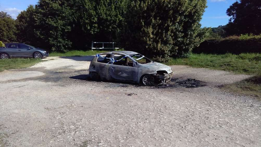 The burnt-out car left at Londonthorpe Wood.