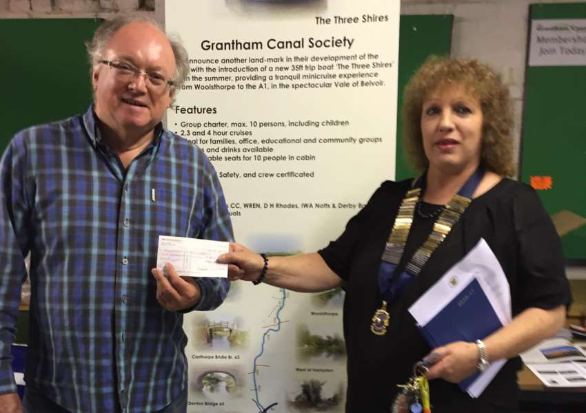 Lions president, Sandie Baker is pictured presenting a cheque to commercial manager, David Lynham Brown EMN-160831-164532001