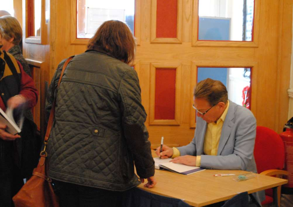 Michael Portillo signs a book at the Guildhall Arts Centre in Grantham.