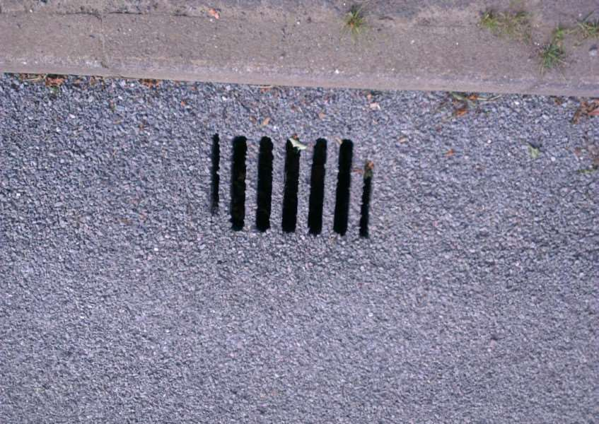 A drain in High Street, Ropsley, filled and covered with gravel. Photo: Derek Hindley
