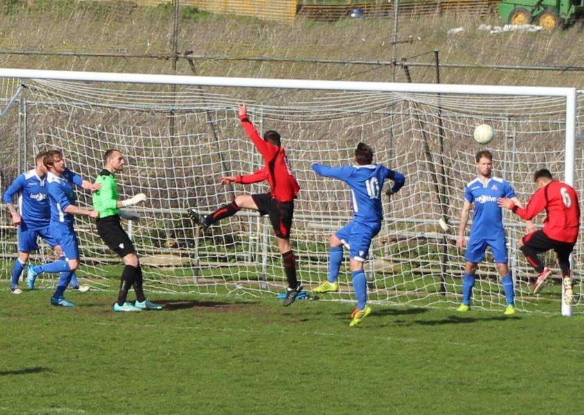 Man-of-the-match Sam Hill (6) nods in at the far post for Harrowby's first goal.