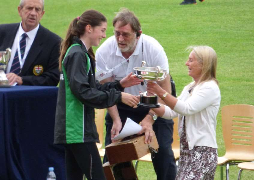 Amy Hunt receives the Group C winner's trophy from ESAA chairman Sue Garvey.