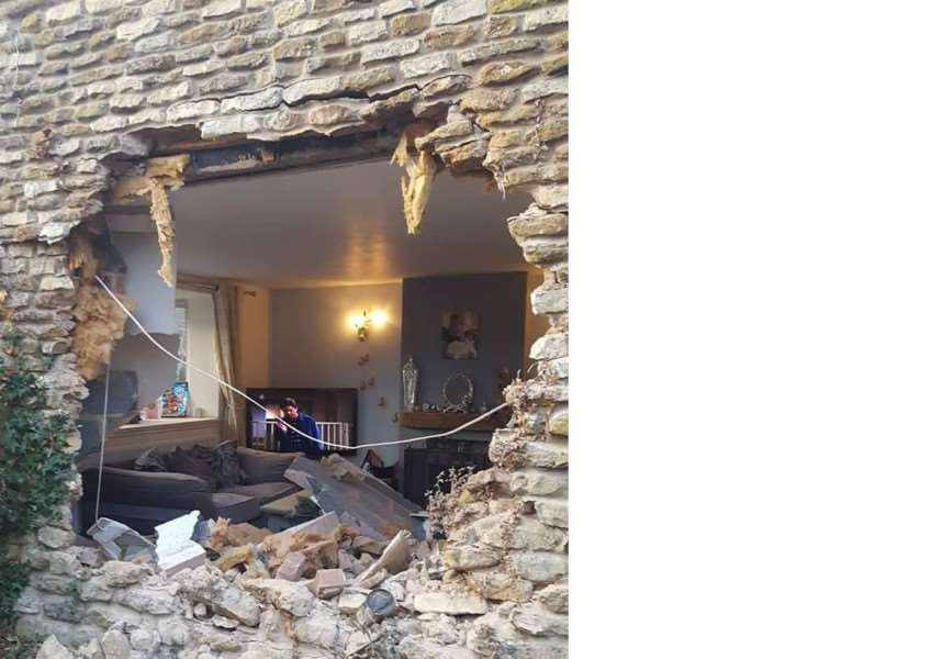 This hole was left in the house in Caythorpe when a lorry slid on ice and crashed. Photo: Facebook