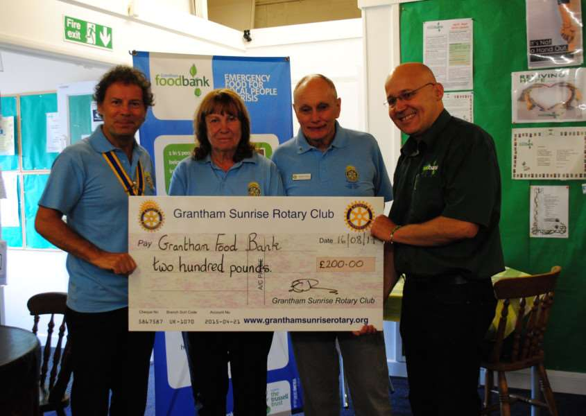 The Grantham Sunrise Rotary Club from left, President Lez Jones, Maggie Welton and Andre Finney presented cheque to Foodbank co-ordinator Brian Hanbury.