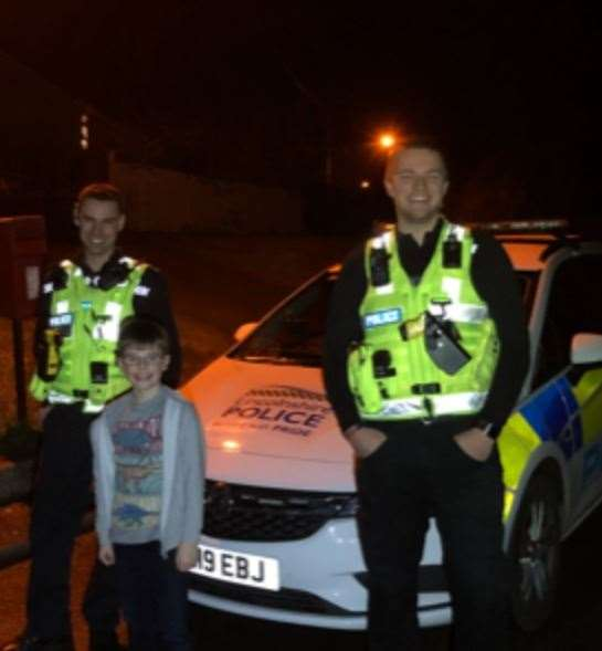 Police officers with the boy they raised money for after he was the victim of a burglary. (28239910)