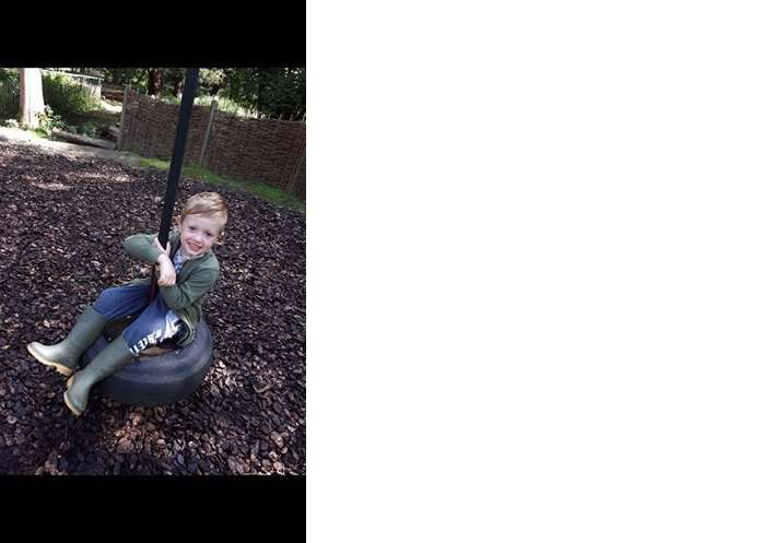Taylor-James having a go on the tyre swing.