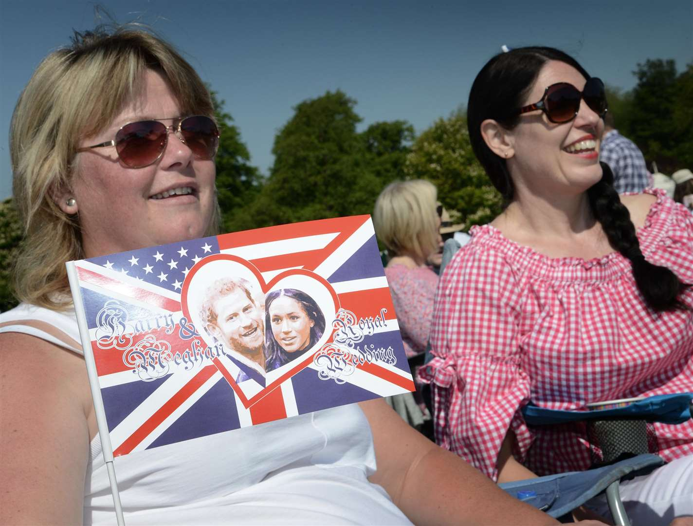 Visitors enjoy the royal wedding on a big screen at Belton House. (2108686)