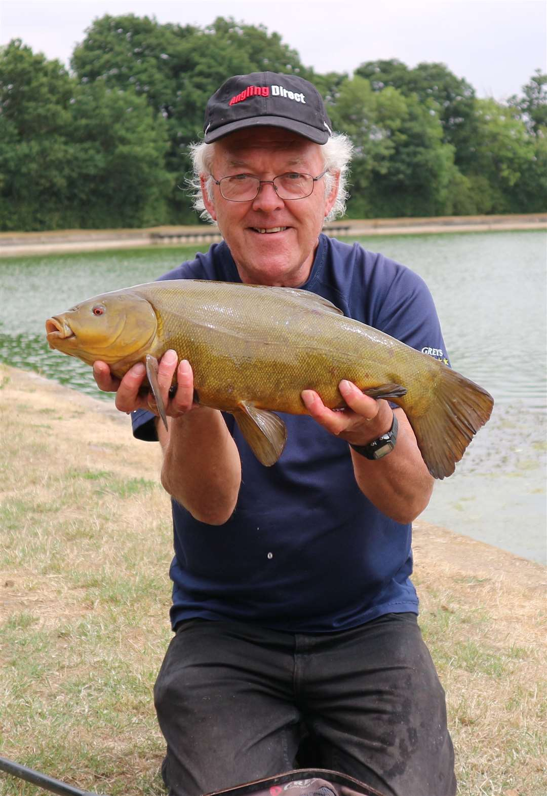 Dave Coster with last year's best tench from 'the Res'. (11708738)