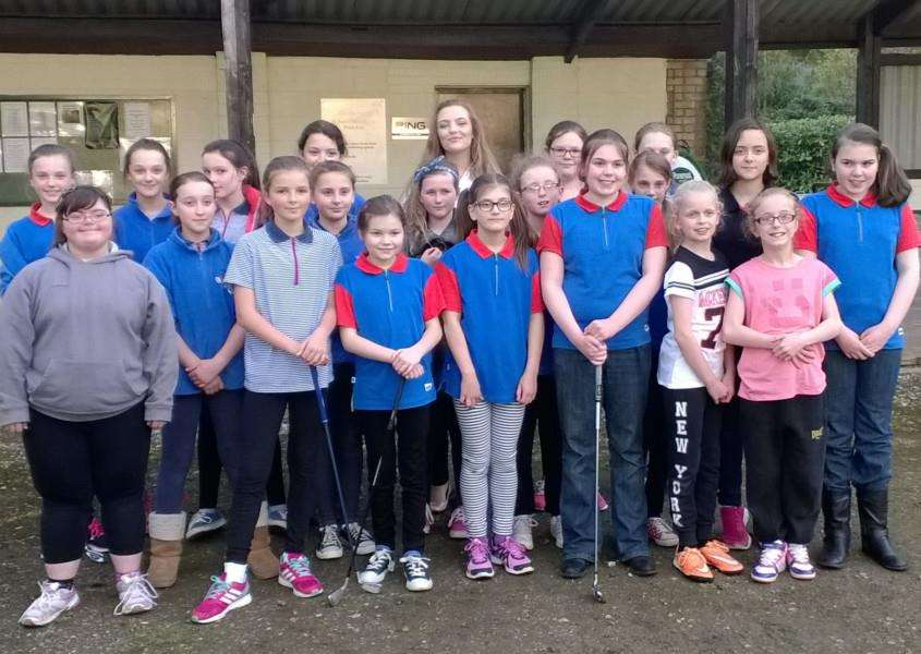 Girl guides enjoy a golf lesson at Belton Woods Golf Club.