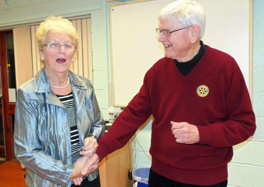Rotary Club of Grantham Kesteven President Elect making cheque Presentation to volunteer Jeannie Priest a volunteer of the Lincs and Notts Air Ambulance.