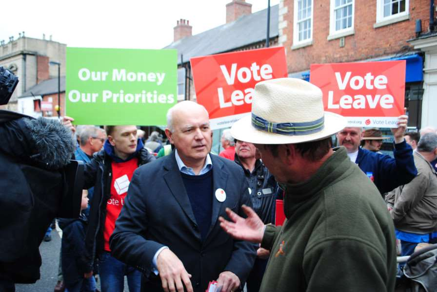 Iain Duncan Smith discusses the EU with people in Grantham market.