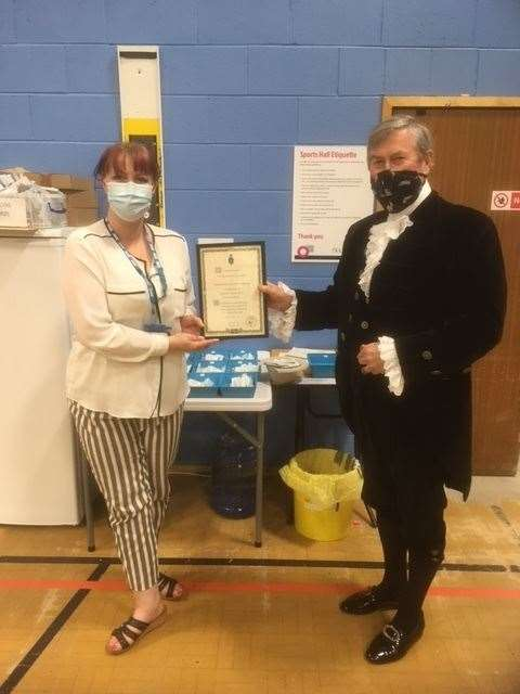 The High Sheriff of Lincolnshire Michael Scott presents a certificate to Jennie Tomlinson, manager of the Grantham vaccination centre. (45867818)