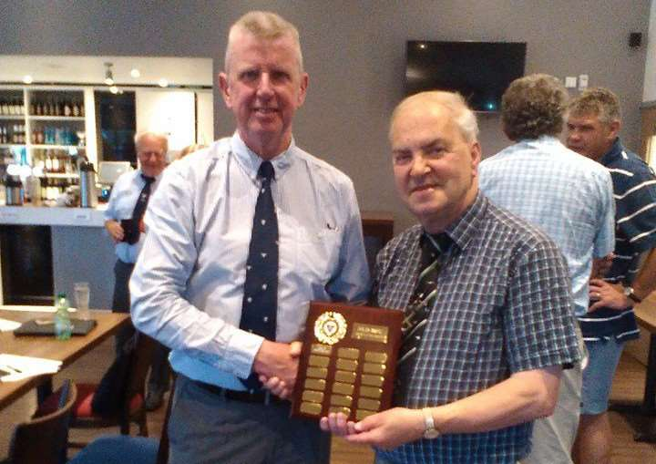 Bill Berridge (right) receives the Spirit of the Game award from NLD president Phil Cass. jZqbARt6b93CqCnY5nzy