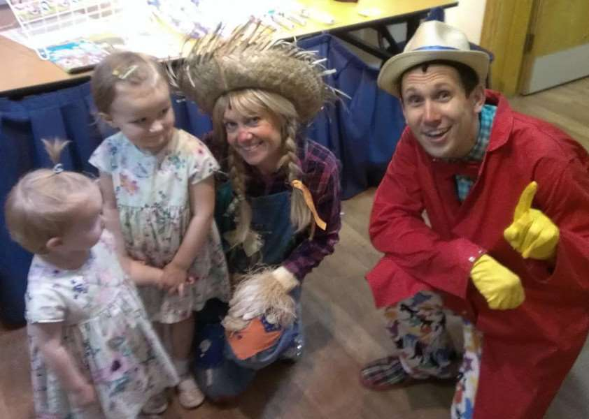 Sally the Scarecrow and The Toymaker meet and greet children after the show.