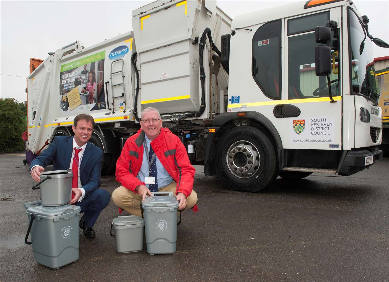 The SKDC Cabinet Member for Environment, Cllr Dr Peter Moseley (right), andLincolnshire County Council's Assistant Portfolio Holder for Commercial and EnvironmentalManagement, Councillor Daniel McNally, with the new food waste collection vehicle. (2858166)