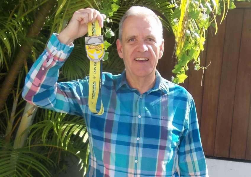 Neil Emerson shows off his medal from Barbados.