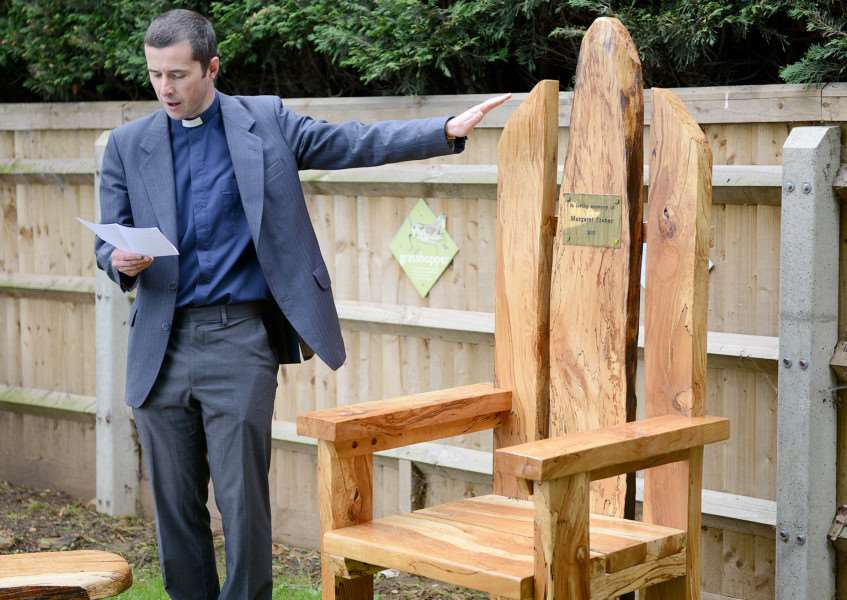 The Rev Chris Boland blesses the storyteller chair at Harrowby Infant School, Grantham