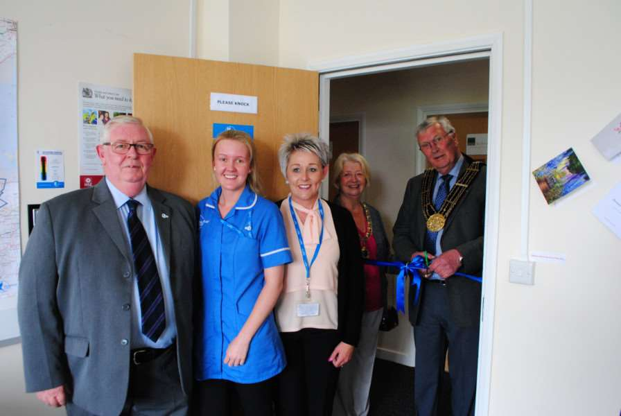 Mayor of Grantham Coun Mike Cook officially opens the Bluebird Care office at Autumn Park in Grantham. With him, from left, are Steve Watters, Chelsea Thomas and Fay Johnson of Bluebird, Mayor's consort Marjorie Cook.