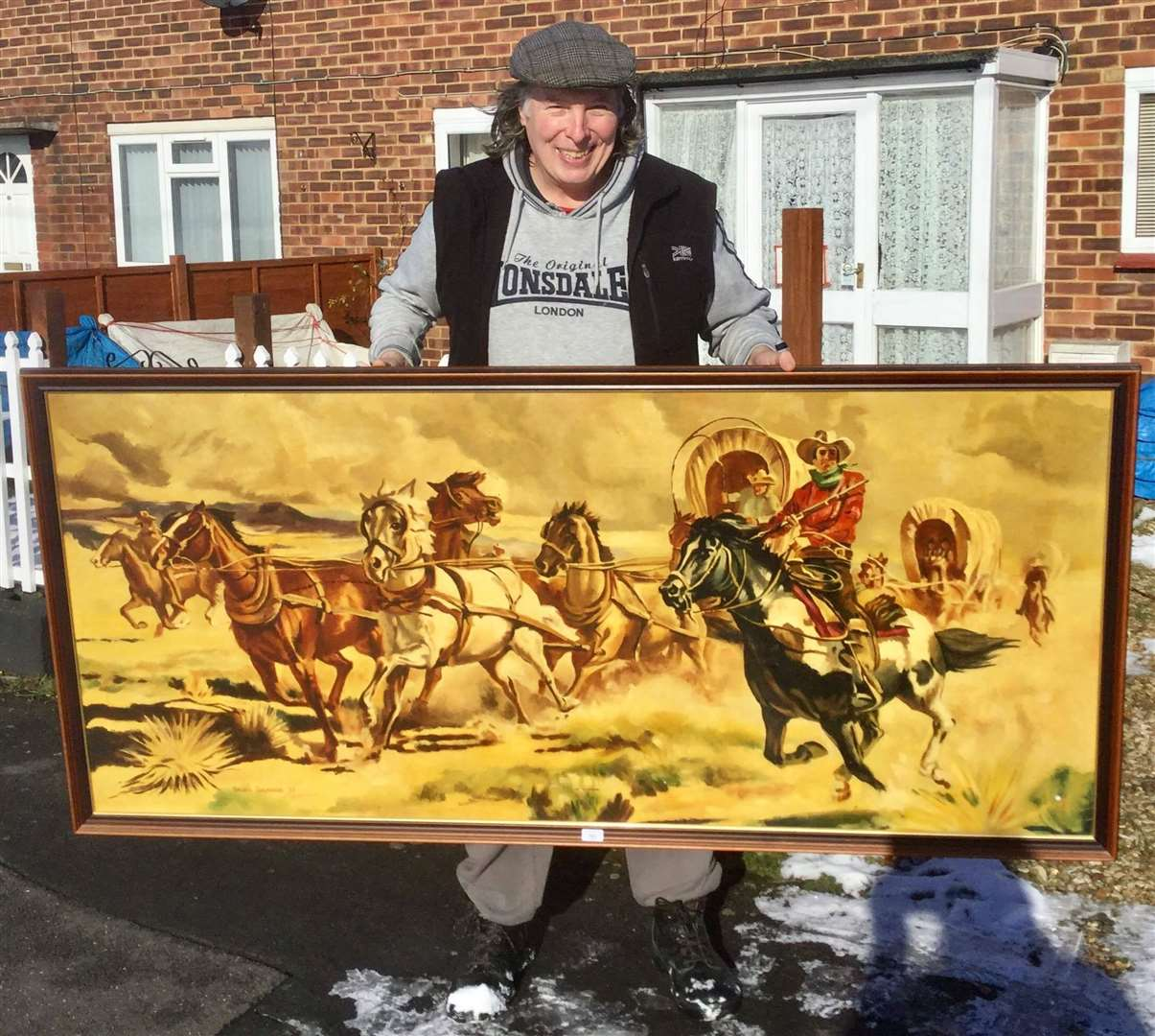 Ian Selby with one of the Terry Shelbourne paintings he bought at auction. (44470289)