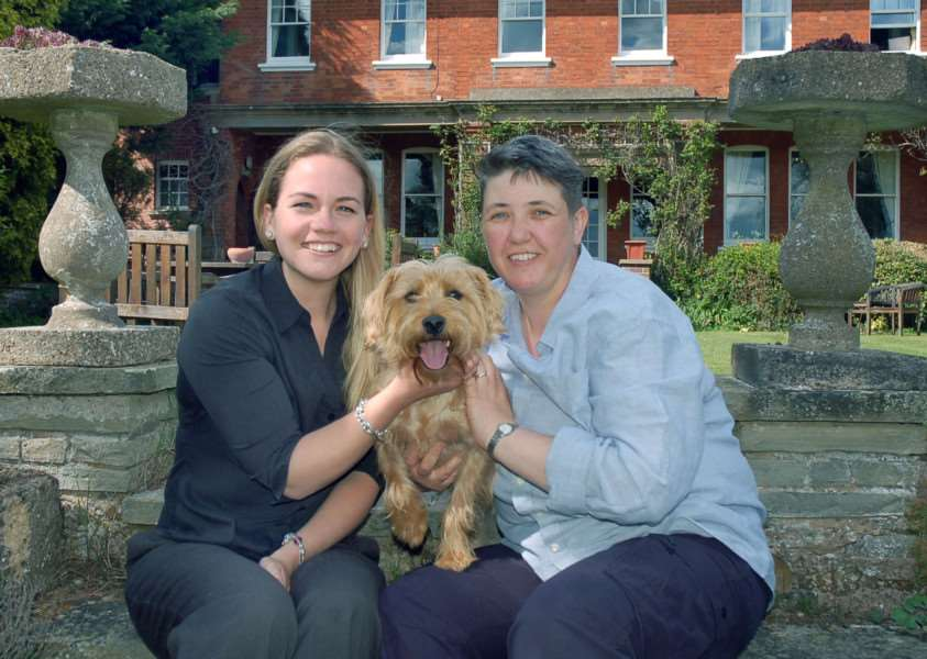 Sarah Browne (right) and her dog Taz are welcomed by Sysonby Knoll manager Vicky Wilkin EMN-150427-132544001