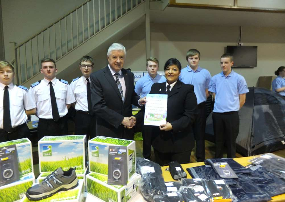Coun Ray Wootten presents Cadet leader PC Tina Demonte with his donation from the Big Society Fund.