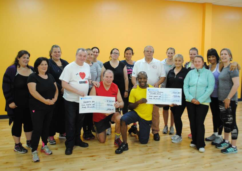 Zumba fund-raisers are pictured with teacher Michael Anderson, Gravity FM's Andy McCall, Grantham Journal Children's Fund chairman Roy Wright and Coun Ian Selby