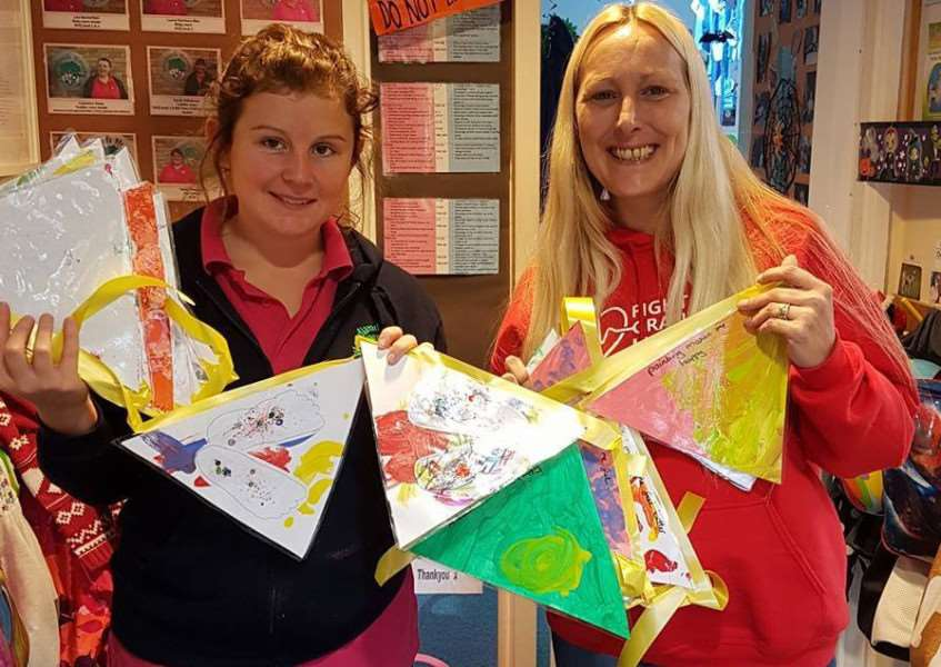 May Burton, pre school room leader at Woodlands nursery with Jody Clark, who is hanging artwork outside Grantham Hospital