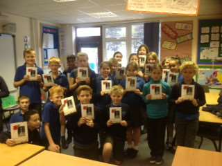 Pupils at Caythorpe and Frieston Village School with their 'Passports of Remembrance'.