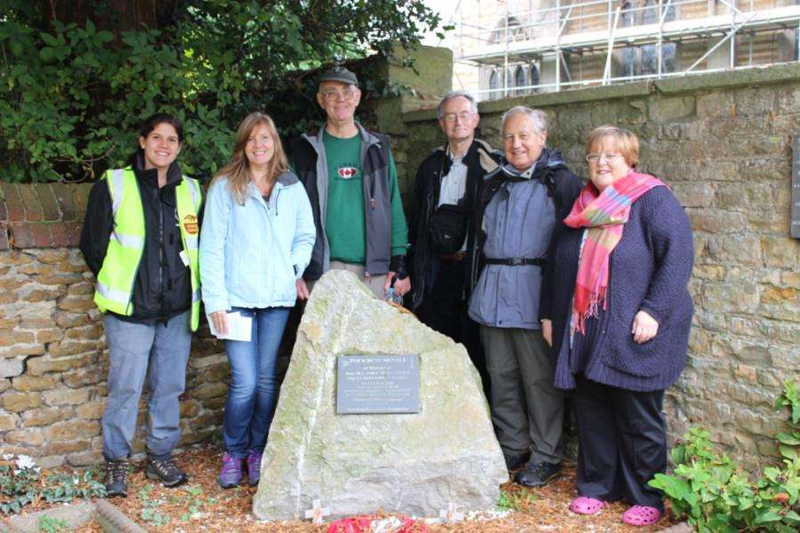 Walkers gather with churchwarden Joanne Russell (right) beside the boulder brought 8,000 miles to commemorate Signals action in the Falklands War.