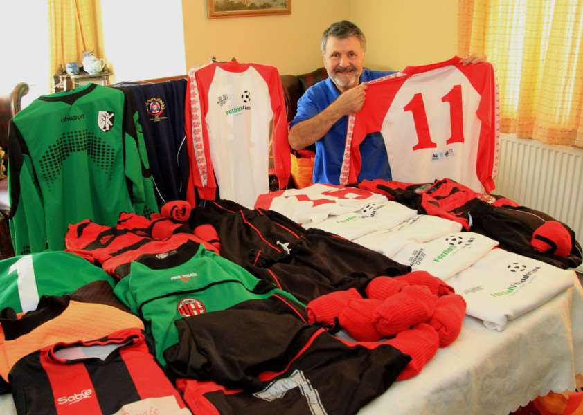 Mos Kalbassi, of the Rotary Club of Grantham, surrounded by the huge amount of football kit to be sent overseas.