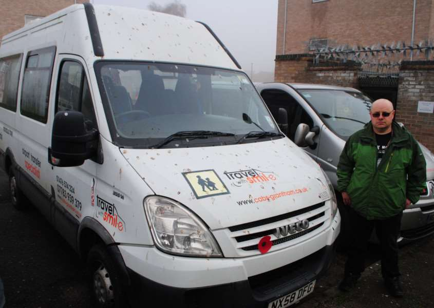 Martin Smil with his bird poop splattered minibus in Kinoulton Court, Grantham.