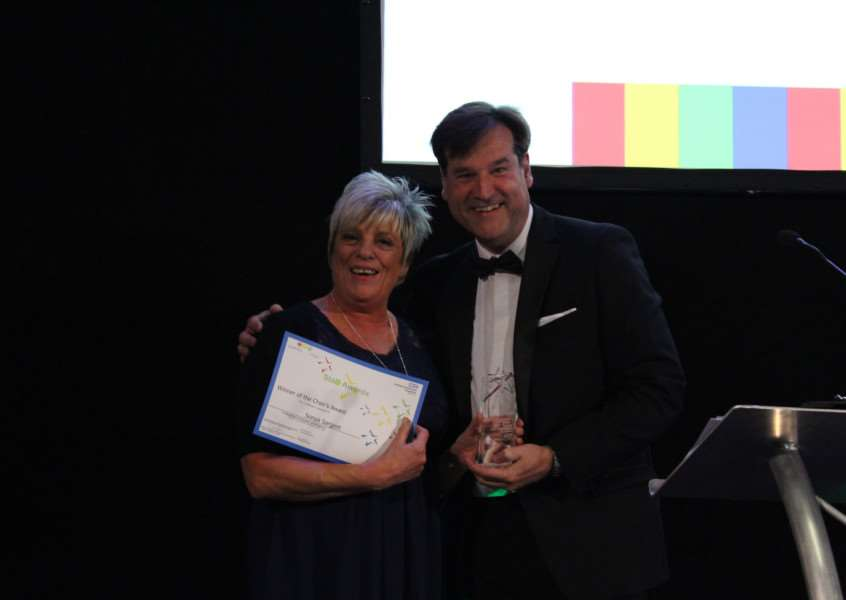 Grantham Hospital porter Sonya Sargent receives the Chairman's Award at the ULHT staff awards from trust chairman Dean Fathers.