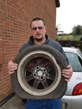 Joshua Scarborough with his flat tyre.