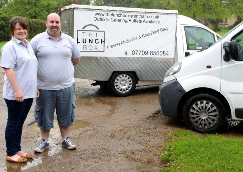 Victoria and Nathan Nicholas-Barry of The Lunch Box with their delivery vans.