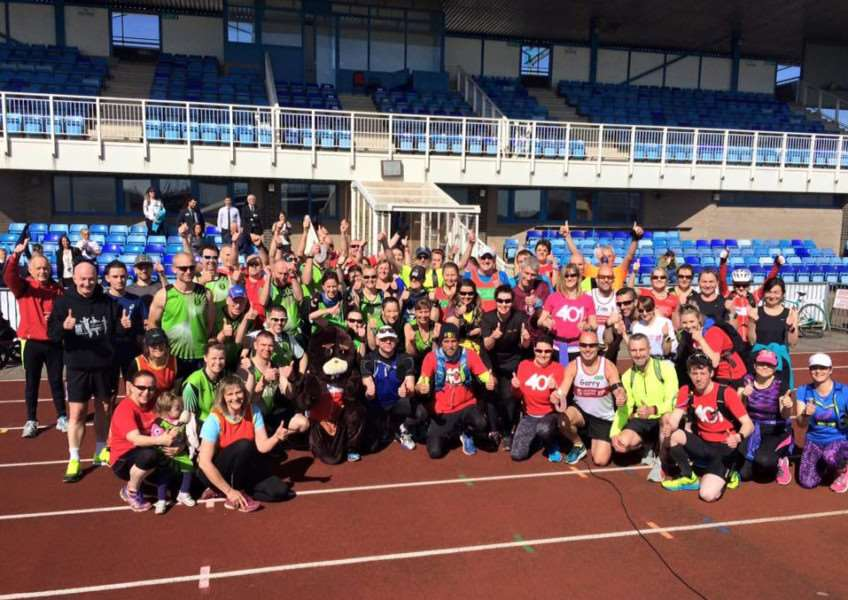 Ben and supporters at the South Kesteven Sports Stadium, where his Grantham marathon began.