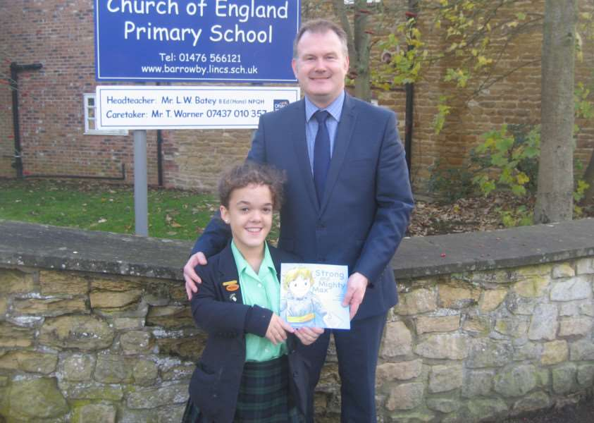 Millie, aged 14 with Mr Batey, headteacher at Barrowby Church of England Primary School EMN-160501-153529001