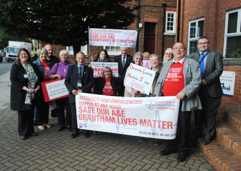Councillors and members of the public join forces in protest at the closure of Grantham A&E department overnight.