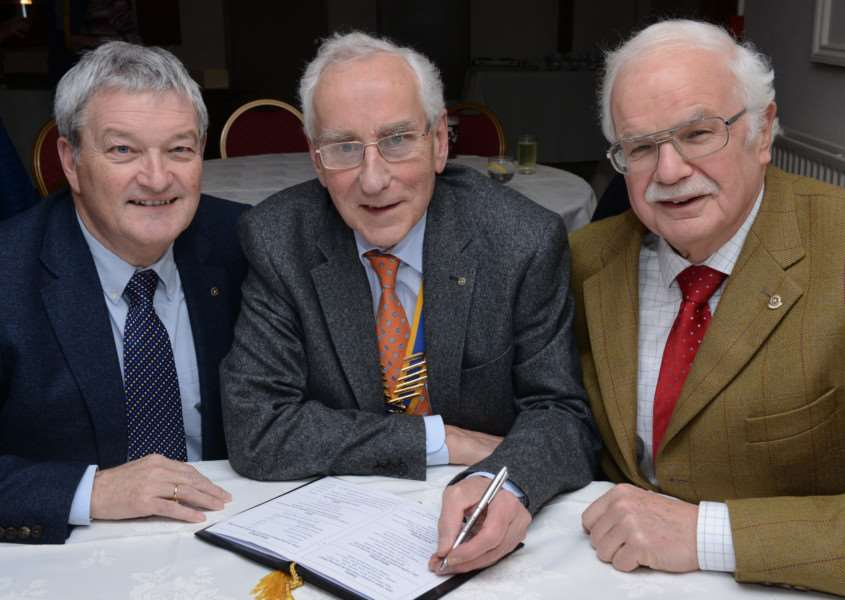 Pen to paper: From left, Ken Ackroyd, president Andrew Redman and Roger Blakeman.
