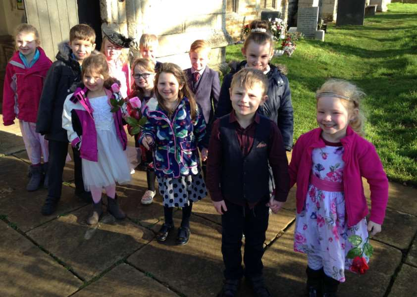 The children dressed in their finery for the special ceremony.