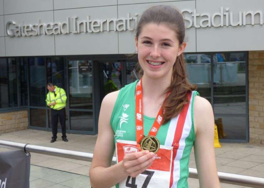 Amy Hunt shows off her English Schools winner's medal.