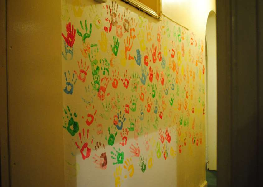 The NCS group worked with the day centre clients to create a feature wall using their painted handprints.