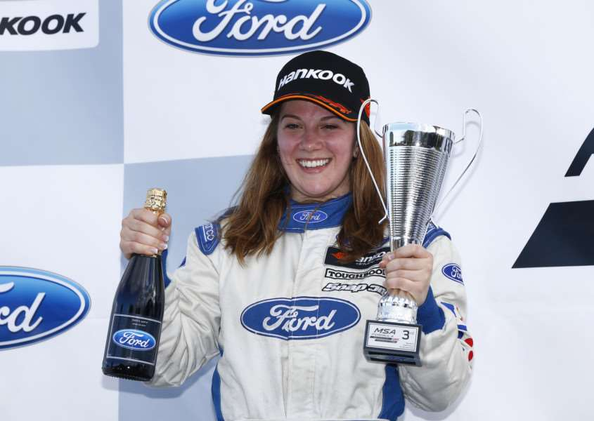Louise Richardson celebrates her third place podium finish at Croft. Photo: Jakob Ebrey