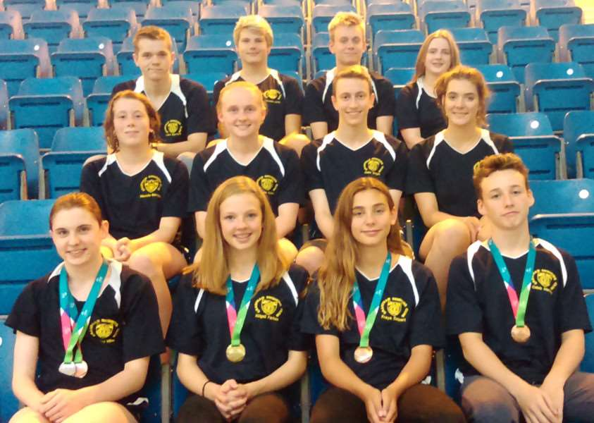 Grantham Swimming Club's national qualifiers with front row medal winners, from left - Hayley, Abigail, Freya and Caleb.