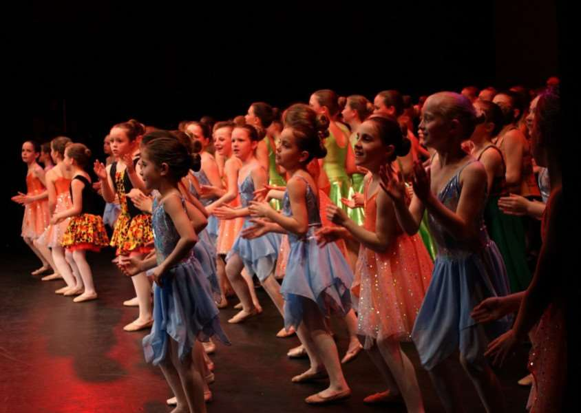 Dancers perform their finale at Newark Palace Theatre.