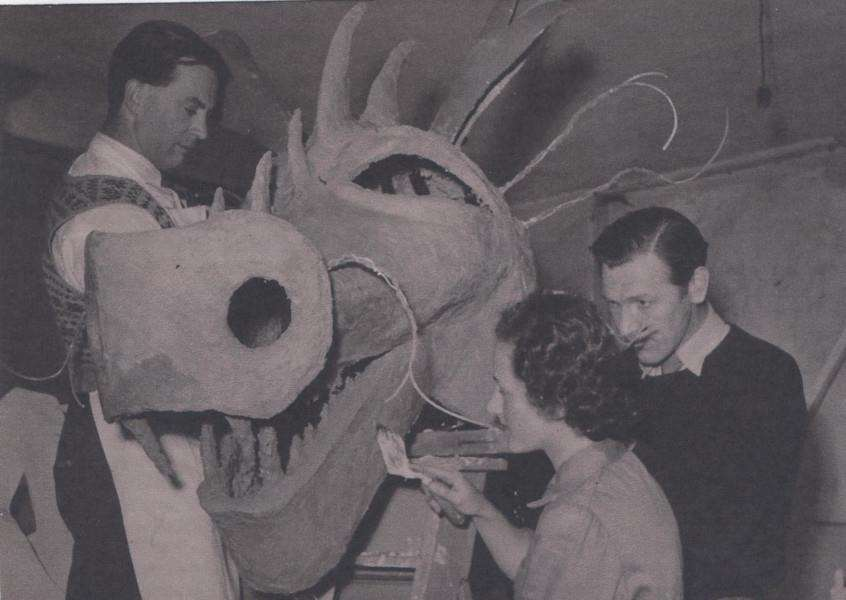 Dragon float being painted by, from left, Herbert Palin, Marigold Ede and J.R. Cocksworth. Photo courtesy of Terry Shelbourne.