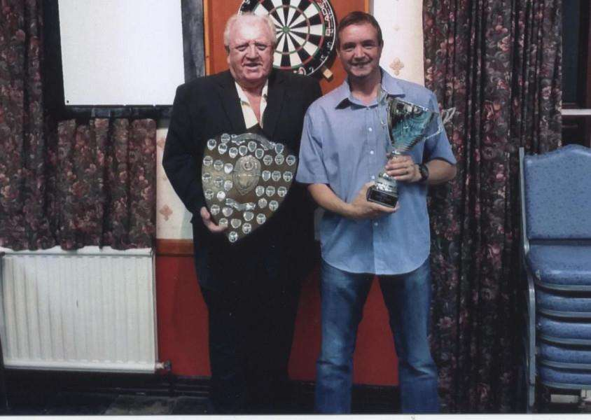 League winner Mick Taylor (right) receives his awards from Lincs Darts Association president John Stanton.