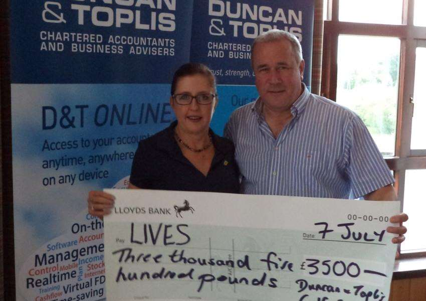 Adrian Reynolds, MD of Duncan and Toplis, presents a cheque for �3,500 to Nikki Silver, of LIVES Lincolnshire, raised from their charity golf day.