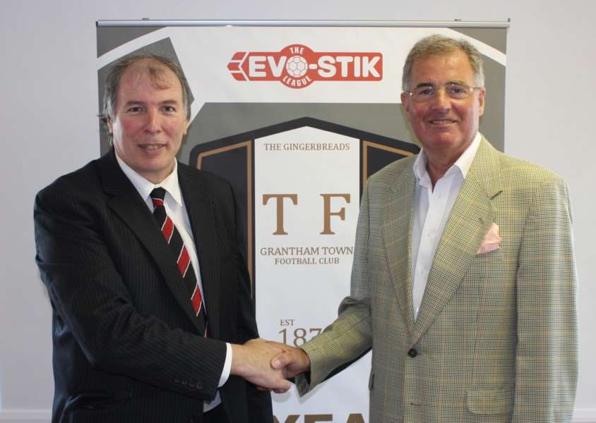 Ian Selby, left, shakes hands with Keith Horton, Chief Executive of Grantham Town Football Club, after becoming Director of Community Engagment.