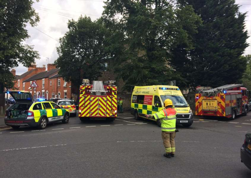 Emergency services in New Street, Grantham, where a convertible vehicle has collided with parked cars.