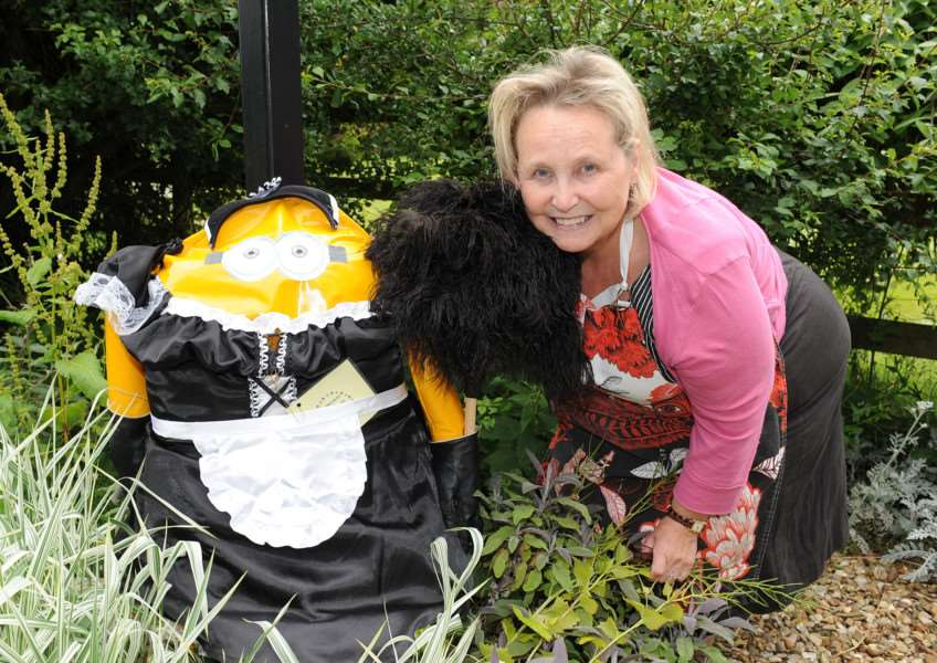 Scarecrow competition and Oasby and Aisby. Deborah Ferguson of Aisby with her French Maid Minion scarecrow. EMN-150107-174922001